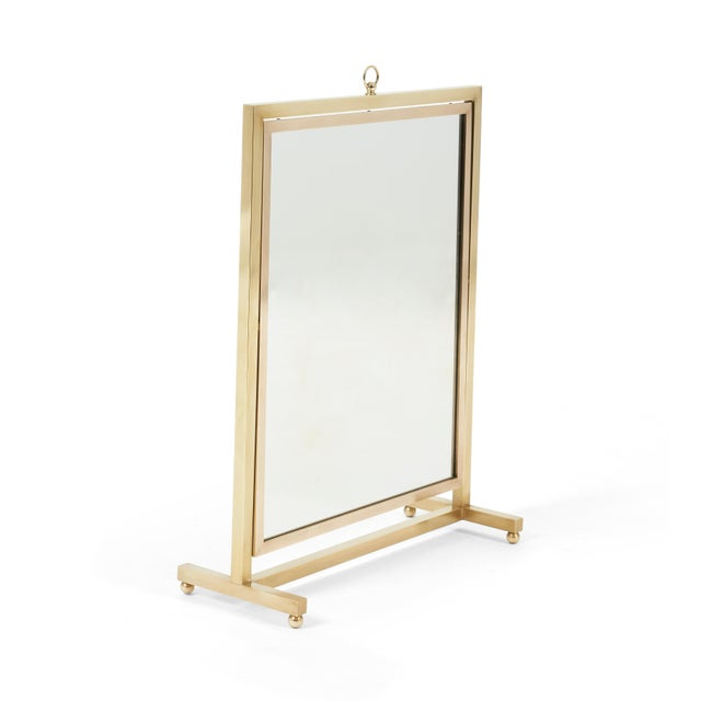 Brass vanity/table top mirror in adjustable stand. Back side of mirror is Italian walnut panel.