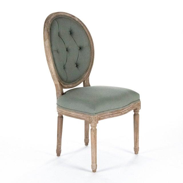 Round tufted back side chair upholstered in sage linen on limed grey oak frame.