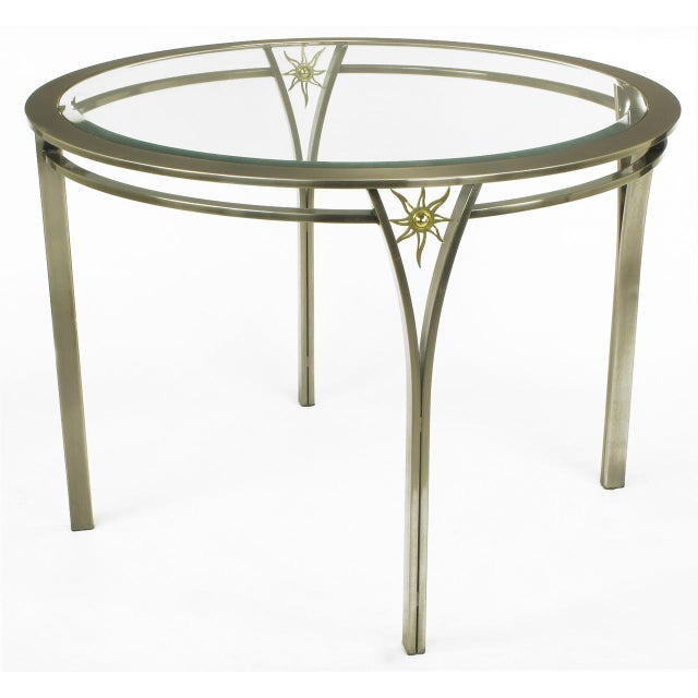 "Uncommon 40"" dining or game table by Design Institute America. Brushed steel double rings with Y shaped legs and a brass..."