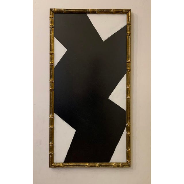 This striking black and white acrylic painting is framed in a vintage gold frame with bamboo carvings. 18 in. wide x 33...