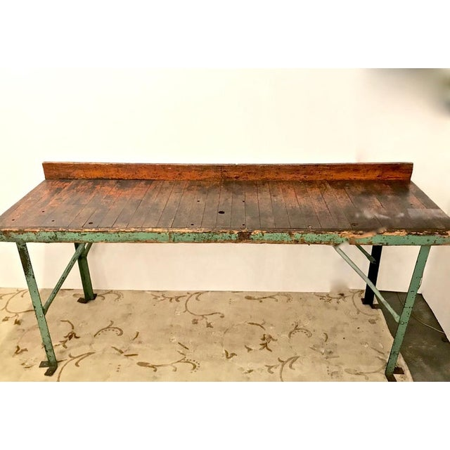 This is exceptional example of a late 19th-early 20th century workbench. The bench appears to retain its original deeply...