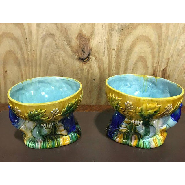 "Pair of Majolica George Jones style ""Punch"" bowls, each with a circular bowl supported by a reclining figure of ""Punch"" on..."