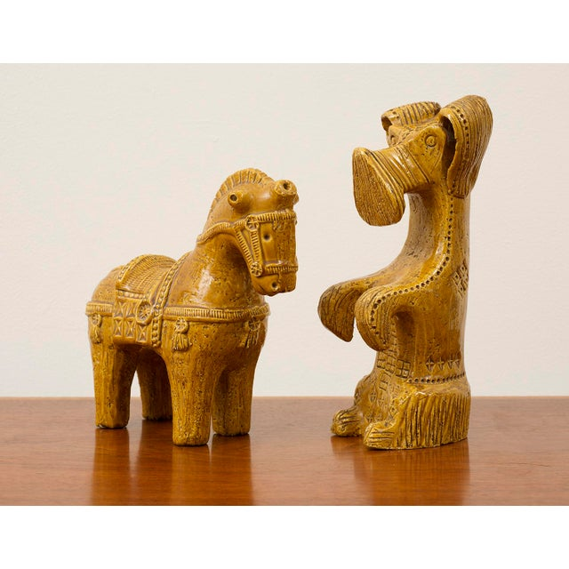"""Matching pair of ceramic sculptures by Aldo Londi in a rare mustard glaze. Bitossi, Italy, 1960s. Dog 13"""" h x 4.5"""" w x 6""""..."""
