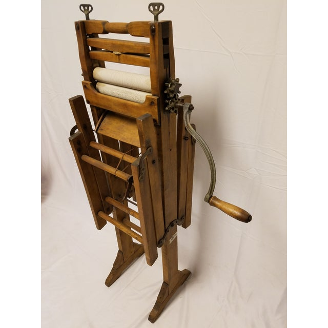 This wonderful hardwood Amish clothes wringer is completely handmade and was used to wash and wring out clothing and...