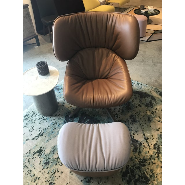 Tabano Swivel Lounge Chair + Ottoman By B&B Italia Tabano is a comfortable design generous in volume that easily adapts to...