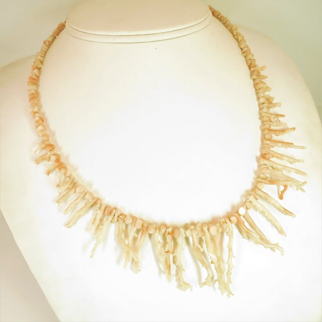 Offered here is an angel skin branch coral necklace from the 1930s. Graduated angel-skin coral branches and nuggets in a...