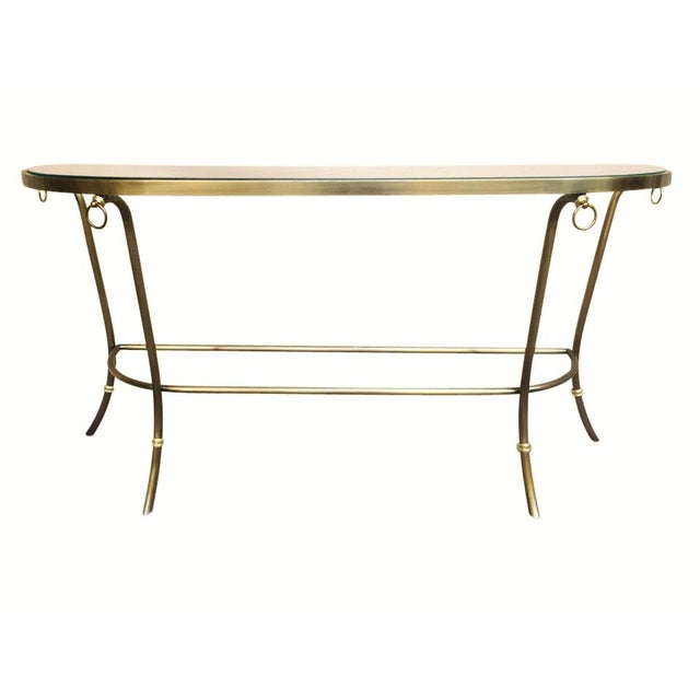 A brushed nickel and glass console table with brass accents by Design Institute of America. The demilune glass sits...