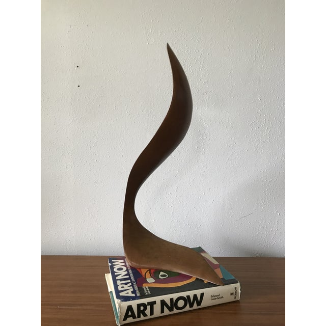 Beautiful mid century abstract sculpture, appears to be made from one solid piece of walnut. Signed illegibly on the...