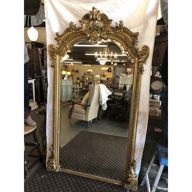 Fine French Louis XV gilt wood and gold leaf mirror consisting of a open cartouche crest with rococo relief carving and...