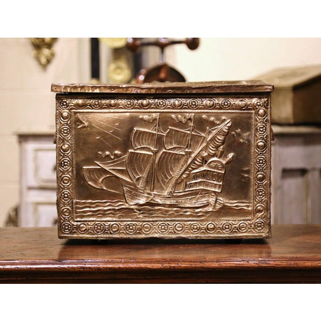 Crafted in France circa 1870 and rectangular in shape, the antique wooden and brass coffer is decorated with repousse...