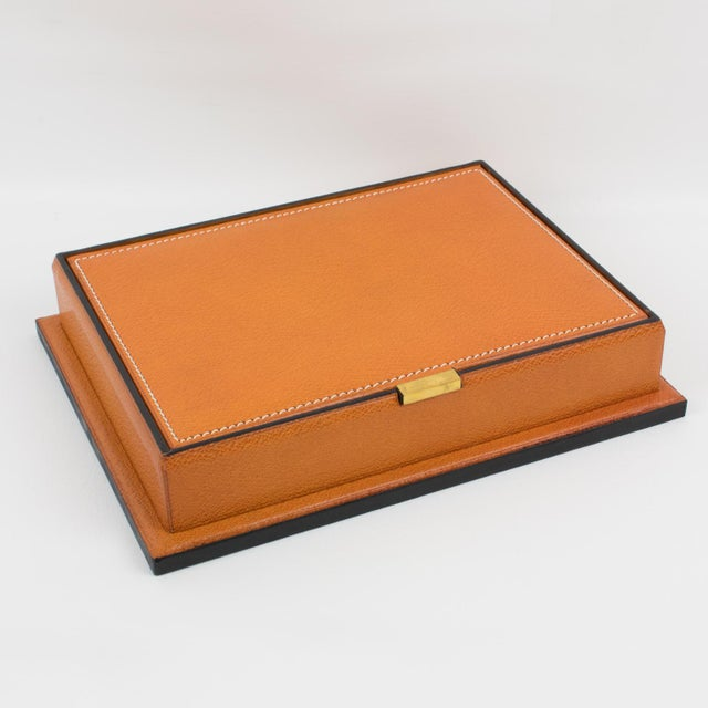 Beautiful 1940s modernist leather decorative box, desk accessory by Longchamp, Paris. Natural light cognac leather with...