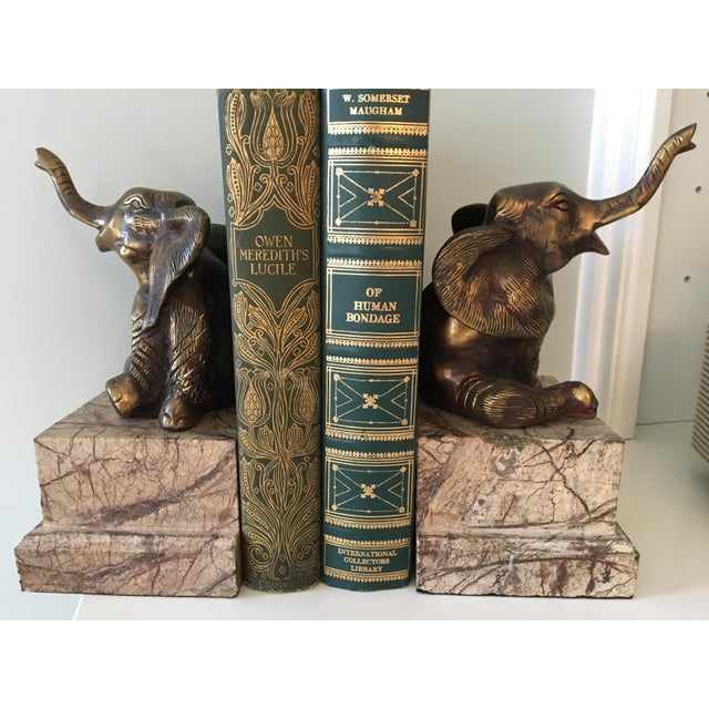 This is a pair of vintage brass elephants on carved marble bookends. This vintage brass is thicker as is the marble which...