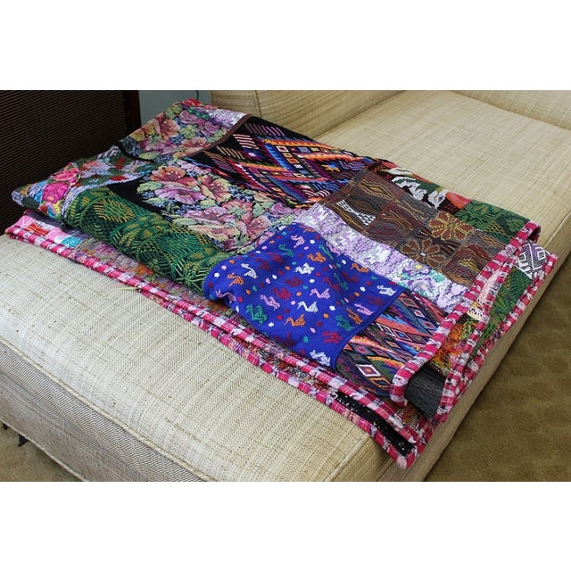 This beautiful and colorful blanket is made with patches of huipiles which is the name of the indigenous blouses of women...