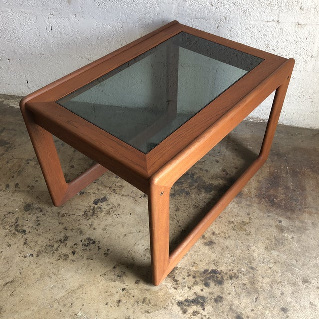 Vintage 1970s Mid Century Modern Danish Side Table by Komfort Furniture. Features a Solid Teak Frame with rounded corners...