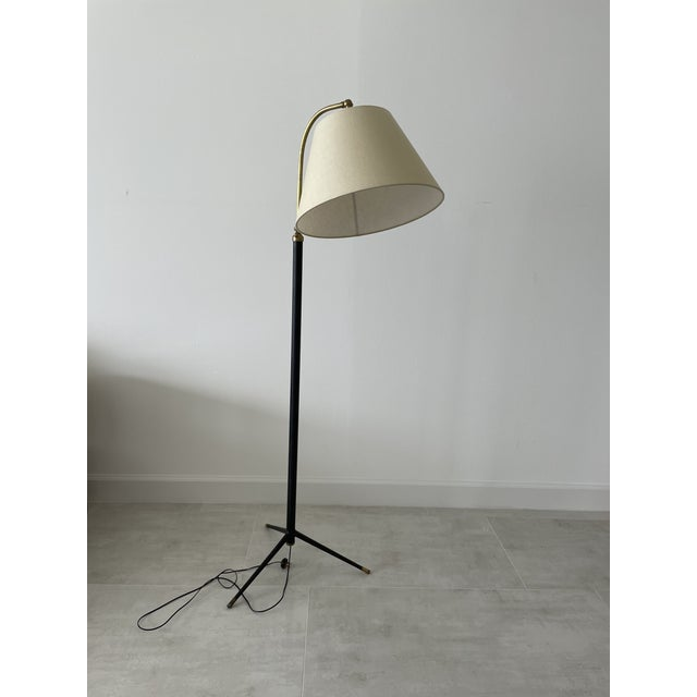 Exquisite French adjustable and articulating floor lamp circa 1950. Recently rewired and outfitted with new linen ecru...