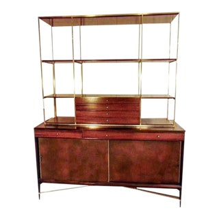Rare Paul McCobb Brass and Mahogany Bookcase With Leather Covered Doors For Sale