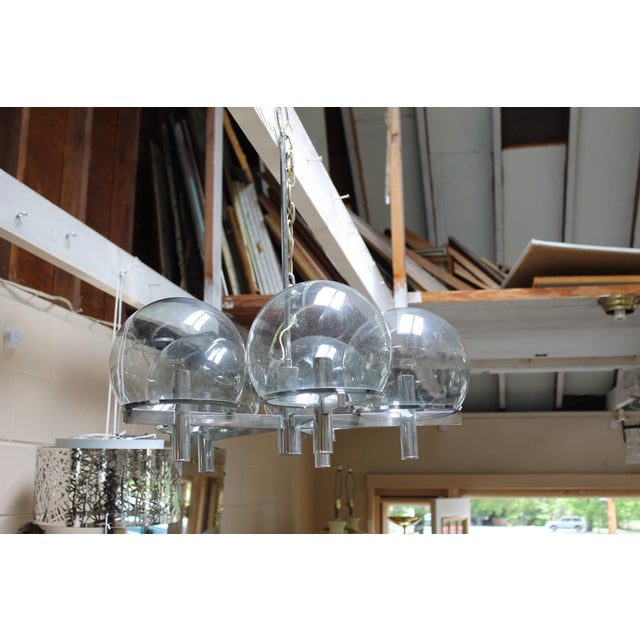 Italian modern five arm chrome and smoked glass globe chandelier by Gaetano Sciolari. Maker of globes was Vianne Glass...