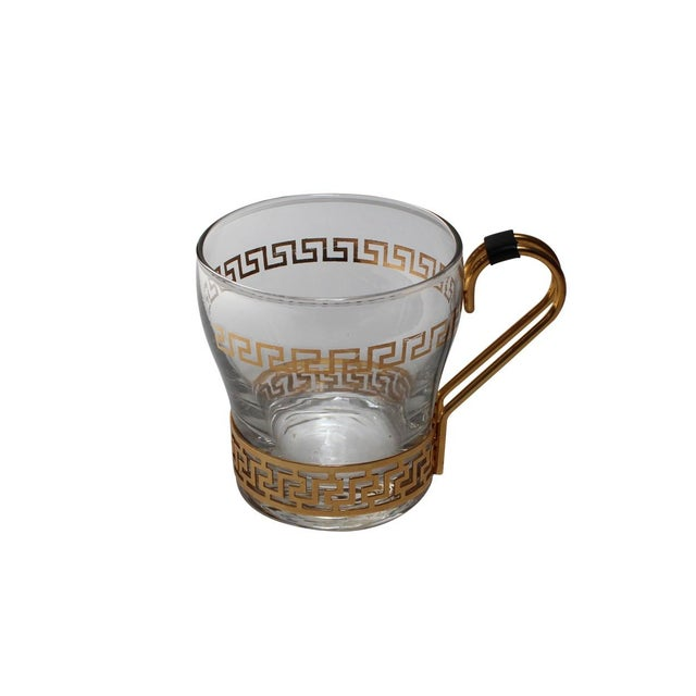 A set of 4 vintage glass coffee cups with a gold greek key pattern at the rim and removable metal handle. These vintage...