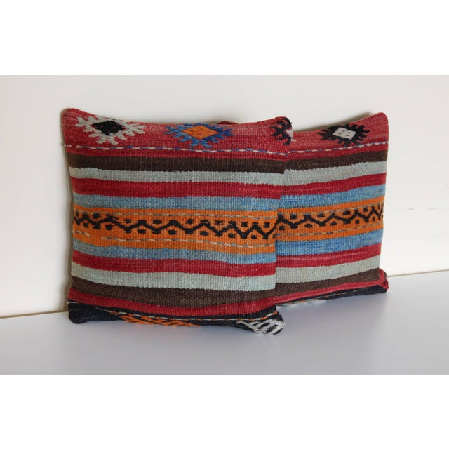 """A pair of handmade pillows measures 16"""" W x 16"""" L each and hand-knotted along the Mediterranean & Aegean coast of Turkey...."""
