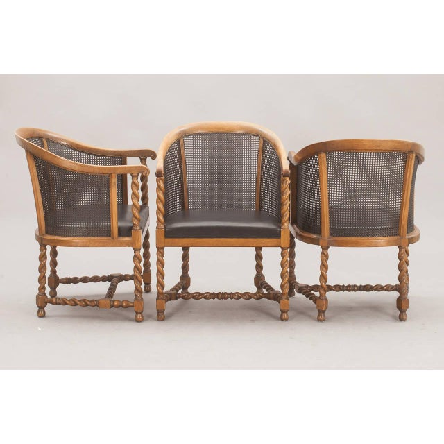 The chairs by Nordiska Kompaniet, Sweden, circa 1926. Stained oak with cane. Manufacturer tug with numbers attached. Price...