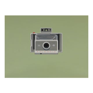 Vintage Polaroid Camera on 60s Green