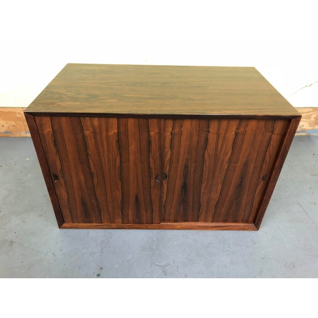 This listing is for a mid century Poul Cadovius rosewood sliding door wall cabinet for a wall unit. Made in the 1960s.