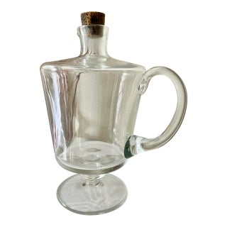 Early American Blown Glass Jug With Shaped Spout and Applied Foot and Handle For Sale