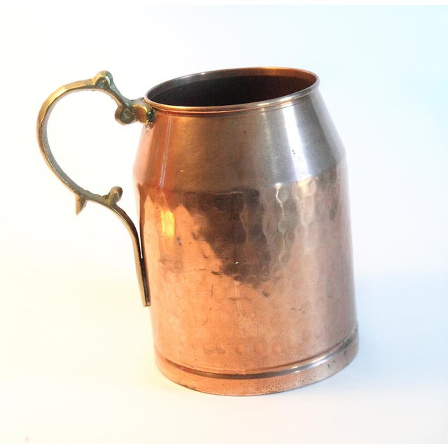 This vintage stein is hammered a hammered copper with a brass handle.  Beautiful patina.