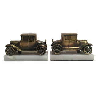 Vintage Brass Car on Marble Bookends - A Pair For Sale
