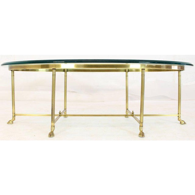 Mid-century modern solid brass oval coffee table. Made in the 1970s.