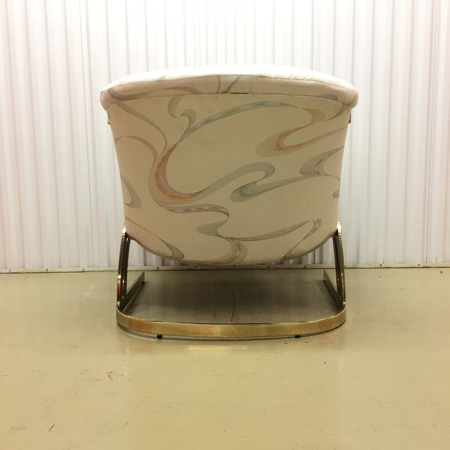 Milo Baughman cantilever brass lounge chair. Large and comfortable chair and ready for some new fabric update. The base is...