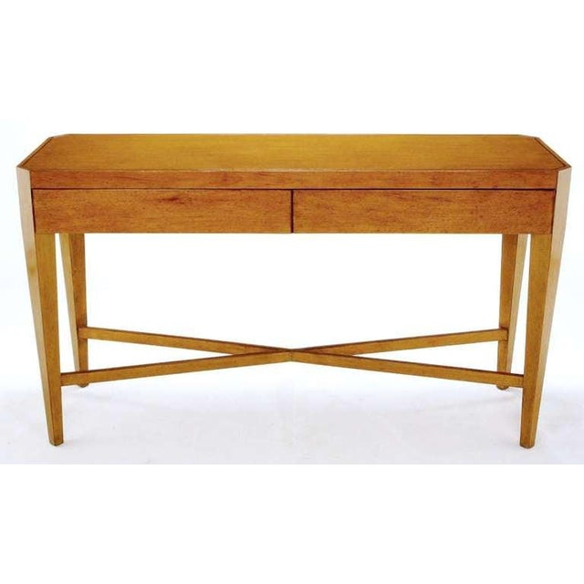 Art moderne style console table by designer Nancy Corzine. The clean lines incorporate canted legs that are supported by a...