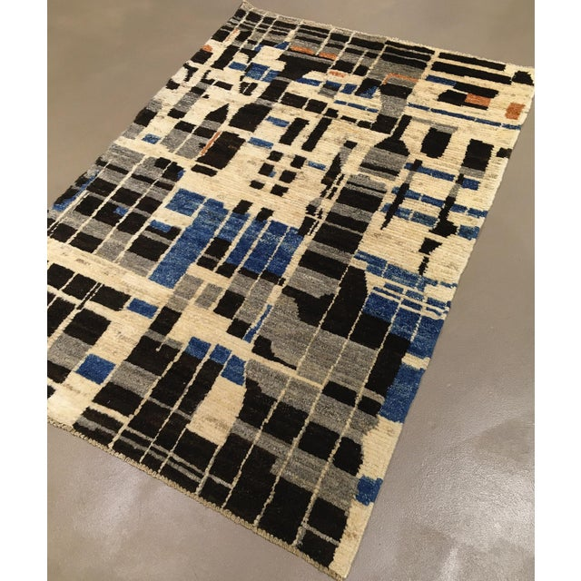 A modern hand knotted wool Modernist rug. A unique, one of a kind rug with elements of Swedish mid century design.