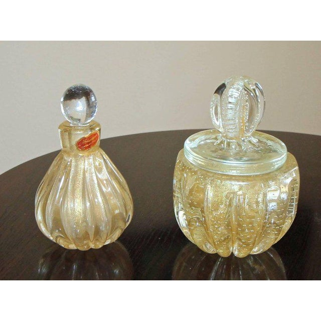 Murano glass perfume bottle and lidded powder jar, each with gold inclusions and controlled bubbles. Measures: size...