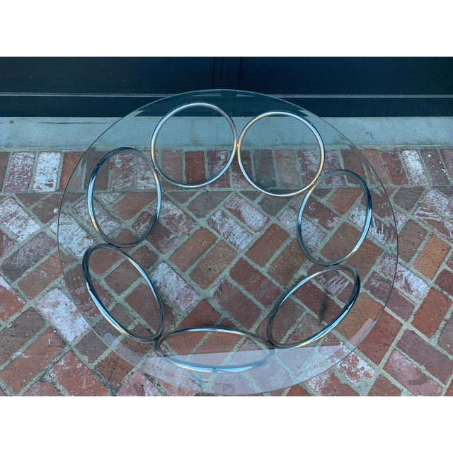 Contemporary loooking Vintage 1970's tubular ring chrome base and glass coffee table. Excellent conditions.