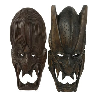 20th Century Tribal Carved Wooden Igorot or Ifugao Bakunawa Masks - a Pair For Sale