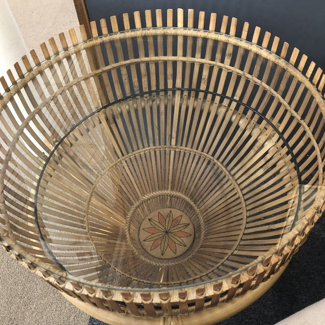 Vintage rattan fish trap side table with glass top in the style of Franco Albini. Made in the late 20th century.