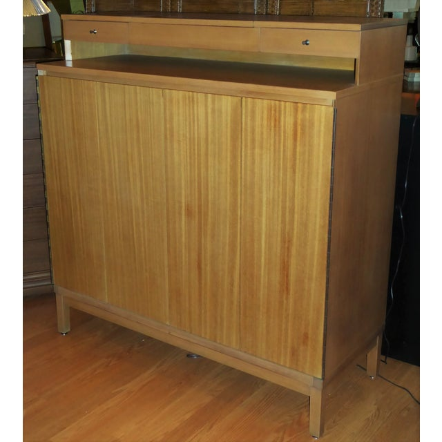 REDUCED FROM $4,500...In blond bleached mahogany, a Paul McCobb for Calvin Gentleman's Chest Dresser from the Irwin...