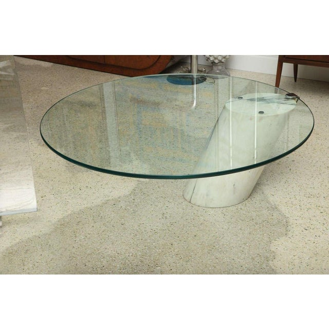 "An angled column of figured marble (17 1/8"" x 13"" x 11"") supports a round glass top with polished edge."