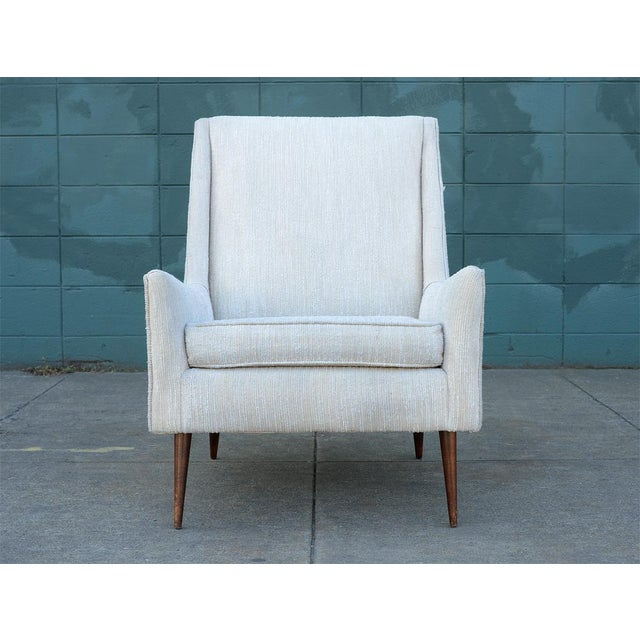This lounge chair is the absolute essence of mid century modern! Everything from its lines, its profile to its silhouette...