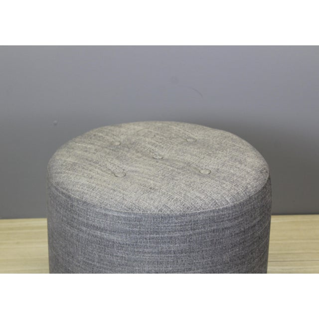 Vintage round ottoman This elegant round ottoman have been newly upholstered in a beautiful gray chenille fabric, in...