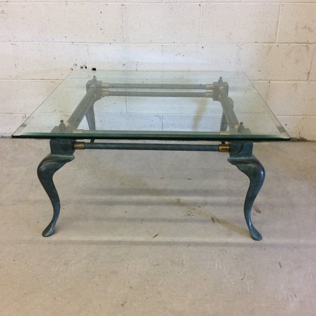 This table is simple, but packs a lot of punch. Incredibly beautiful forged metal frame with blue green patina all over...