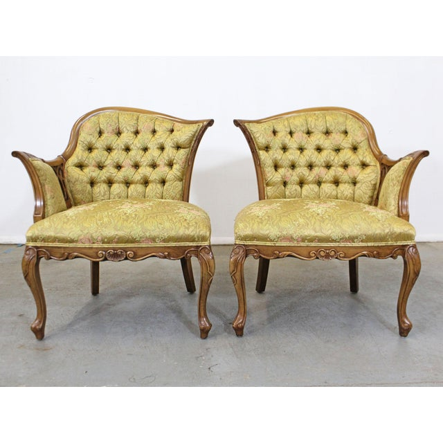 Offered is a pair of vintage French fireside chairs with beautiful tufted upholstery with a floral print. Features...