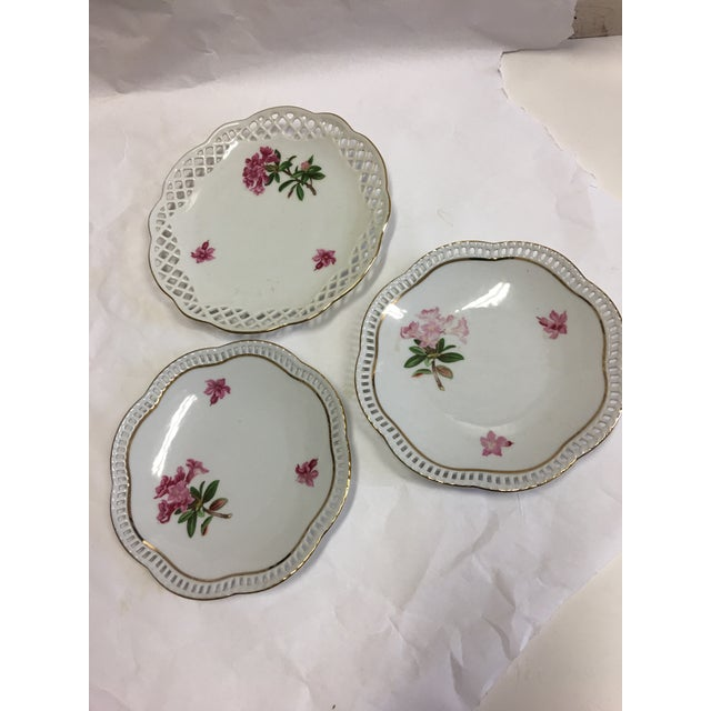 Three beautiful Porcelain plates with red flowers by Bavaria Schumann. Great filigree edge with a gold trim. Great decor...