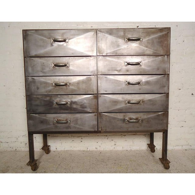 Vintage factory storage unit featuring unique bowed front drawers, set on heavy duty casters. Hand stripped, sanded,...