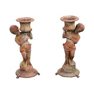 Antique Pair of Cast Iron Garden Statue Planters W/ Cherubs Holding Urns For Sale