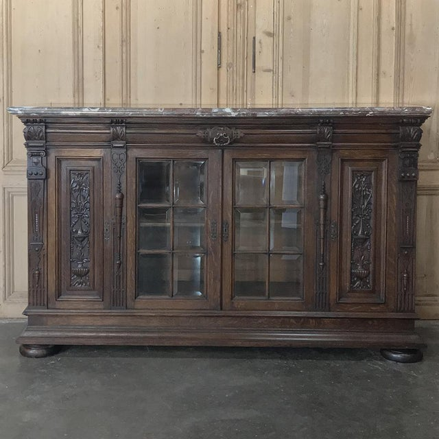 19th Century French Louis XIV Marble Top Display Buffet features elaborate architectural detail on the cornerposts and...