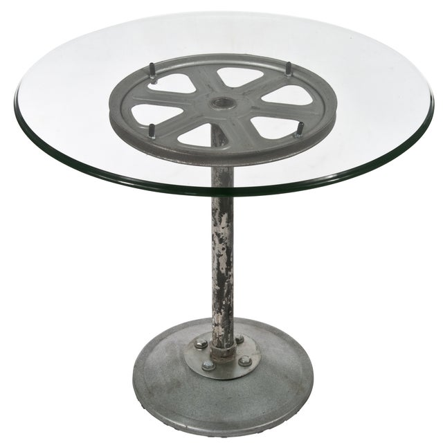 One-of-a kind side table created from salvaged metal industrial parts. Floating tempered glass top. Stunning statement piece.
