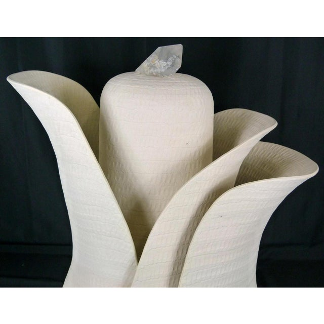 Guy Dawson Blooming Flower studio pottery sculpture. Three curved structures wrap around the structure of phallic-form...