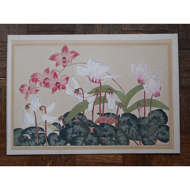 This mid 20th century Japanese woodblock print depicts a group of flowering plants. Printed on one side only and laid down...